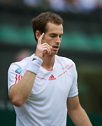 LONDON, ENGLAND - Tuesday, June 26, 2012: Andy Murray (GBR) looks to the heavens as he celebrates winning the Gentlemen's Singles 1st Round match on day two of the Wimbledon Lawn Tennis Championships at the All England Lawn Tennis and Croquet Club. (Pic by David Rawcliffe/Propaganda)