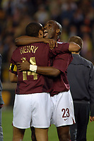 Photo: Francesc Valcarcel.<br />Villarreal v Arsenal. UEFA Champions League. Semi Final, 2nd Leg. 25/04/2006.<br />Thierry Henry (L) and Sol Campbell of Arsenal celebrate victory.