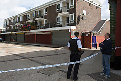© licensed to London News Pictures. London, UK 13/08/2013. Police officers investigating Spey Street in Poplar, east London where 16-year-old Ajmol Alom was found stabbed. Photo credit: Tolga Akmen/LNP