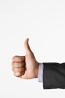 Man making thumbs-up sign against white background close up of hand