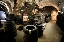 UK ENGLAND LONDON 22MAR14 - City Tyres shop underneath a railway arch in Whitechapel, London's east end.<br /> <br /> jre/Photo by Jiri Rezac<br /> <br /> © Jiri Rezac 2014