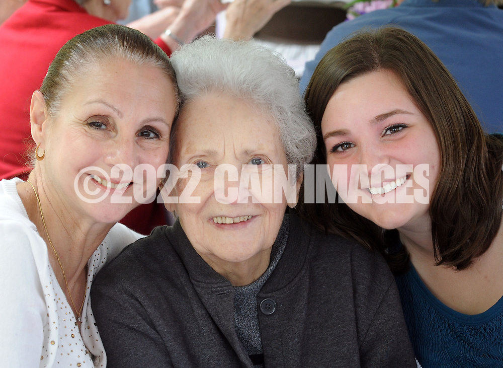 From left, Pam Frazier, of Bensalem, Pennsylvania, her mother Pat Panizzi and her daughter Nicole Jones of Holland, Pennsylvania pose for a photo during a Mother's Day luncheon on the grounds of Spring Village at Floral Vale for their patients and their families Saturday May 9, 2015 in Yardley, Pennsylvania. (Photo by William Thomas Cain/Cain Images)