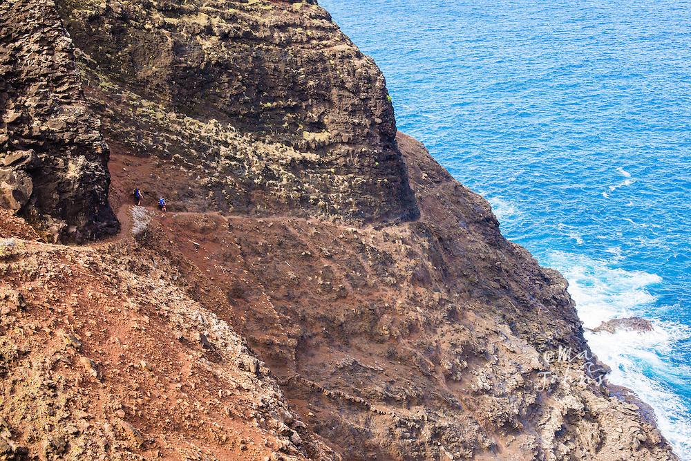 Mother and son hiking on the Na Pali Coast, Kauai, Hawaii