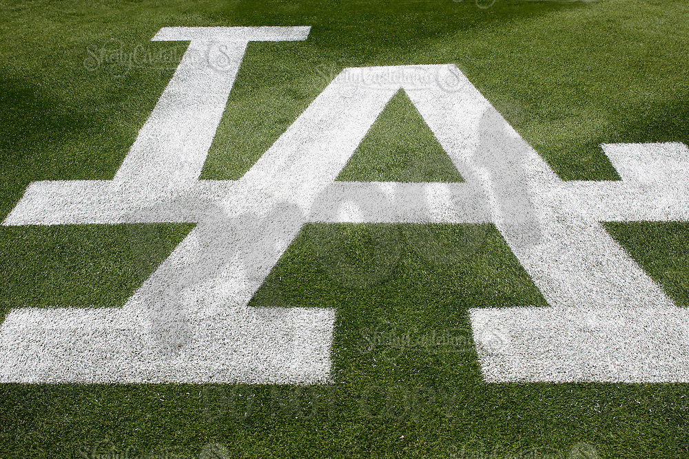 27 May 2013: The Los Angeles Dodgers MLB logo white paint on green grass behind home plate.