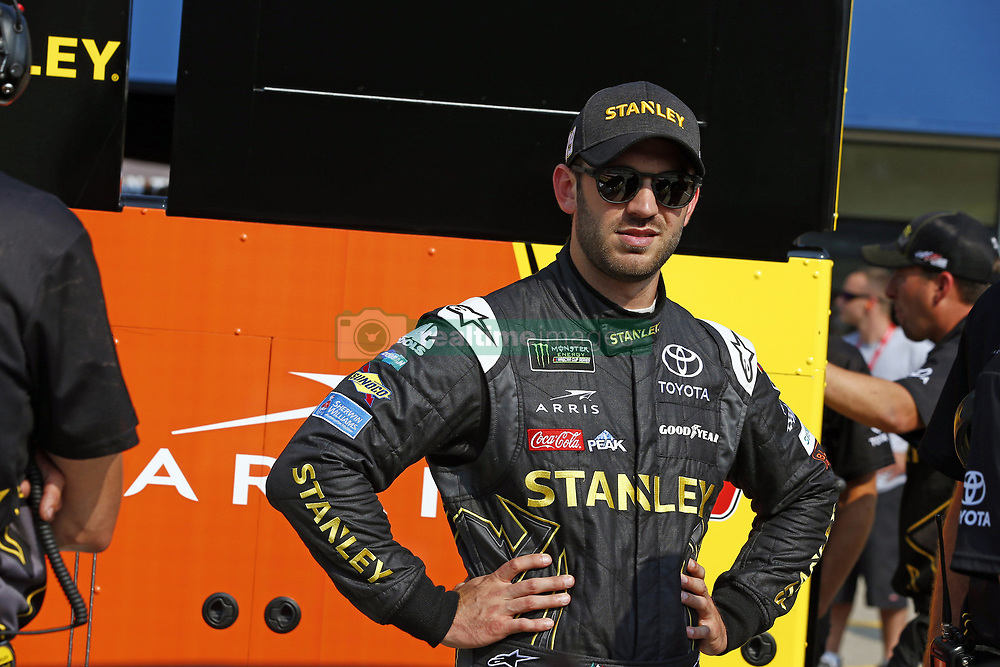 August 10, 2018 - Brooklyn, Michigan, United States of America - Daniel Suarez (19) hangs out on pit road prior to qualifying for the Consumers Energy 400 at Michigan International Speedway in Brooklyn, Michigan. (Credit Image: © Justin R. Noe Asp Inc/ASP via ZUMA Wire)