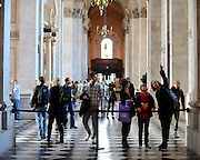35559258© Licensed to London News Pictures. 28/10/2011. London, UK. Visitors explore the cathedral. A Eucharist service held at St Paul's Cathedral today. St Paul's Cathedral reopened its doors at midday today. The Cathedral had been closed over health and safety fears from the Occupy London protest outside.  Photo: Stephen Simpson/LNP