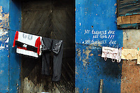GHANA,Accra,Jamestown, 2007. Enigmatic graffiti decorates this wall in Jamestown, one of the poorest but proudest areas of old Accra.