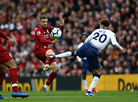 Football - 2018 / 2019 Premier League - Liverpool vs. Tottenham Hotspur<br /> <br /> Jordan Henderson of Liverpool and Dele Alli of Tottenham Hotspur challenge for the ball, at Anfield.<br /> <br /> COLORSPORT/ALAN MARTIN