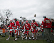 Canandaigua players return to the field after halftime of a game against Pittsford in Canandaigua on Saturday, April 11, 2015.
