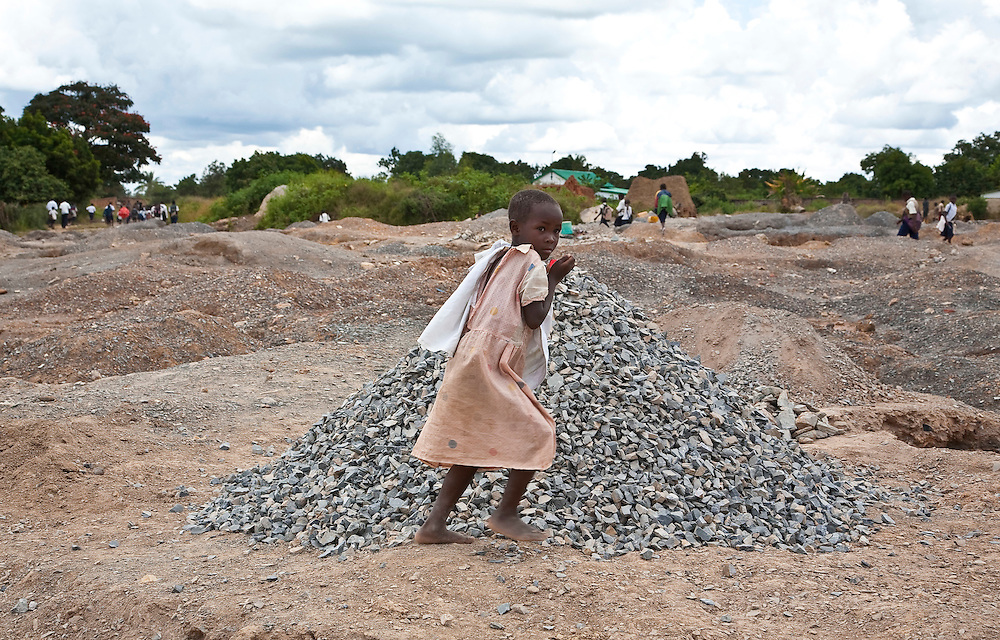 March 2009, Kipushi, DRC. Kipushi was shut in 1993 because of a lack of finance when it was in the Gecamines (state-owned mining company) stable.  Kipushi was mined for 68 years until closure of the mines resulted in massive job losses that led to (mostly) women and children being forced to break up stones and other discarded materials, to earn an income. A dire way to earn an income.