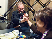 "28 OCTOBER 2010 - PHOENIX, AZ: Terry Goddard ""high fives"" host Stella Paolini (CQ) during her radio show. Goddard appeared on the Spanish language radio show, ""Mujeres Unicas"" (""Unique Women"") (CQ) hosted by Stella Paolini (CQ) on 1190AM, on Oct 28. Goddard lost the election to sitting Governor Jan Brewer, a conservative Republican.     PHOTO BY JACK KURTZ"