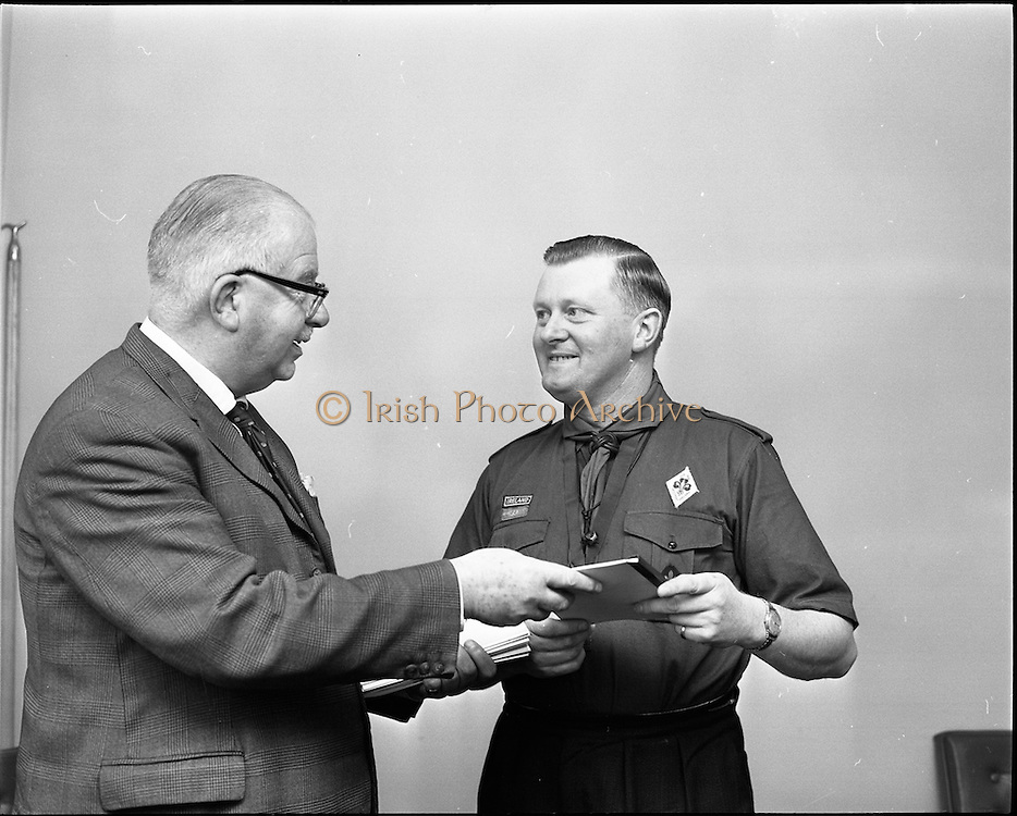 17/09/1968<br /> 09/17/1968<br /> 17 September 1968<br /> Presentation of savings booklets by Mr H.E.F. Hall, Chairman, National Savings Committee to a Scout leader from Westport Co. Mayo at t the National Savings Committee Headquarters, St. Stephen's Green, Dublin.