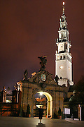 Czestochowa, Poland. Jasna Gora Monastery (Black Madonna) at night with gate and church tower illuminated.