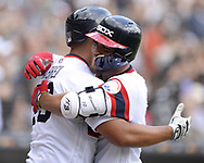 CHICAGO - JULY 15:  Yoan Moncada #10 hugs Jose Abreu #79 of the Chicago White Sox after Moncada hit a home run against the Kansas City Royals on July 15, 2018 at Guaranteed Rate Field in Chicago, Illinois.  (Photo by Ron Vesely)  Subject: Yoan Moncada; Jose Abreu