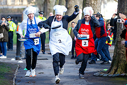 © Licensed to London News Pictures. 28/02/2017. London, UK. LORD PORTER, TIM LOUGHTON MP and GEORGE GIBB race at the annual Rehab Parliamentary Pancake Race outside the Parliament on Shrove Tuesday, 28 February 2017. Photo credit: Tolga Akmen/LNP