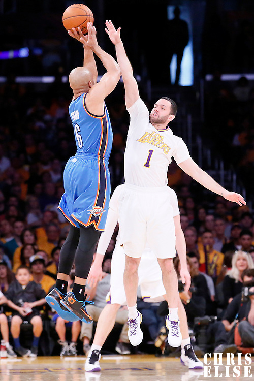 09 March 2014: Oklahoma City Thunder point guard Derek Fisher (6) takes a jumpshot over Los Angeles Lakers point guard Jordan Farmar (1) during the Los Angeles Lakers 114-110 victory over the Oklahoma City Thunder at the Staples Center, Los Angeles, California, USA.