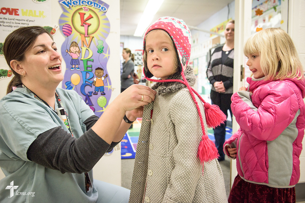 Kindergarten teacher Linda Pfeiffer bundles up a student for recess on Friday, Oct. 28, 2016, at First Immanuel Lutheran School in Cedarburg, Wis. LCMS Communications/Erik M. Lunsford