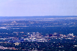 A view of downtown Colorado Springs, Colorado from atop Cheyenne Mountain. Note: This image was originally produced on film and scanned to produce a digital file.  Some dust may be visible from that scan