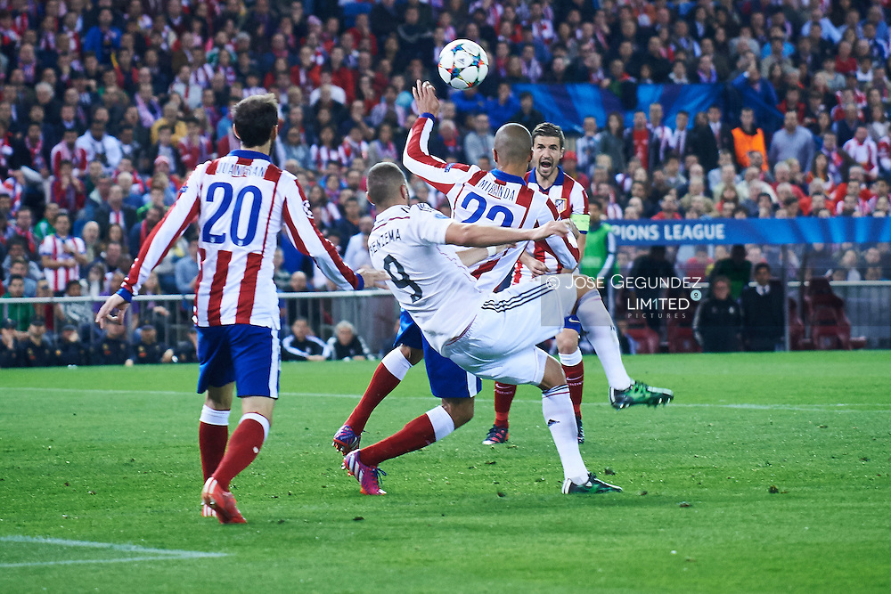 Karim Benzema (Real Madrid F.C.) and Cerci in action during the Champions League, round of 4 match between Atletico de Madrid and Real Madrid at Estadio Vicente Calderon on April 14, 2015 in Madrid, Spain
