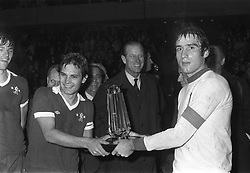 File photo dated 27-10-1975 of The Duke of Edinburgh presents The Prince Philip Cup to Chelsea captain Ray Wilkins, left, and Italian under 23's Captain Francesco Graziani at Stamford Bridge, London.