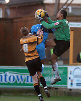Photo: Ian Hebden.<br />Boston United v Wycombe Wanderers. Coca Cola League 2. 18/02/2006.<br />Boston Keeper Michel Kuipers (R) picks the ball off Wycombe's Jermaine Easter (C) who is pushed by Boston's Asa Hall (L).