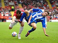 Photo: Ed Godden.<br />Bristol City v Brighton & Hove Albion. Coca Cola League 1. 02/09/2006. Richard Keogh (L) is tackled by Brighton's Doug Loft.
