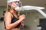 Brooke Kinsey, OHIO cross-country runner, is tested in the Gait Lab with physical therapist Robert Wayner and excerise physiology professor Michael Clevidence.