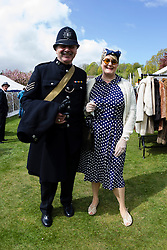 © Paul Thompson licensed to London News Pictures. 16/05/2015. Haworth, West Yorkshire, UK. A policeman and a housewife at Haworth 1940s weekend, an annual event in which people dress in period costume and visit the village of Haworth to relive the 1940s. Photo credit : Paul Thompson/LNP