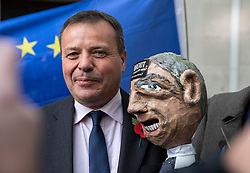 © Licensed to London News Pictures. 04/11/2018. London, UK. Co-founder of the Leave.EU campaign Arron Banks poses with a puppet of Nigel Farage brought by anti-Brexit protesters as he leaves BBC Broadcasting House. Photo credit: Rob Pinney/LNP
