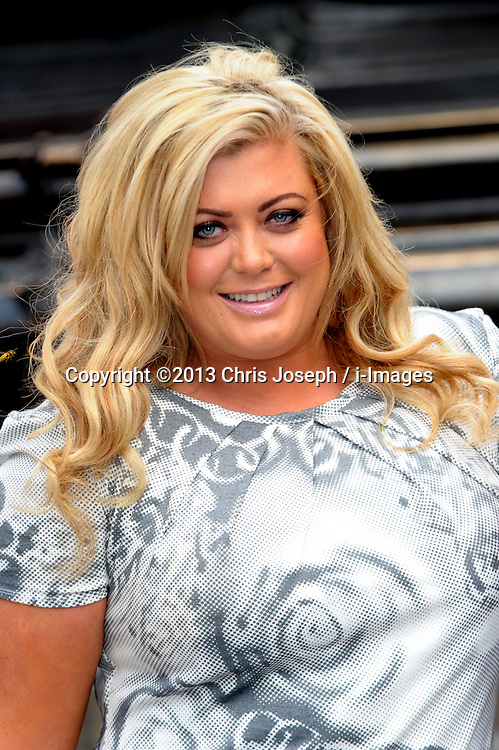 Gemma Collins - PETA<br /> TOWIE star unveils her new ad for animal rights charity PETA in which she's pictured wearing 'nothing but a smile and faux pearls', shot by celebrity photographer Karl Grant, Piccadilly Circus, London, United Kingdom. Tuesday, 10th September 2013. Picture by Chris Joseph / i-Images