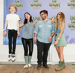 © Licensed to London News Pictures. 13/06/2015. Isle of Wight, UK.   Four YouTube musical artists at Isle of Wight Festival 2015, Day 3 Saturday. From Left to Right - Toby Randall, Hannah Trigwell, Only1Noah (real name Noah Guthrie) and Alicia Olivia. The artists are due to will have performed on the Platform One stage, it is the first time YouTube artists have ever performed at a major festival.   This afternoon as started with warm sunshine.  Yesterday the rain was torrential.  Headline acts include The Prodigy, Blur and Fleetwood Mac.   Photo credit : Richard Isaac/LNP