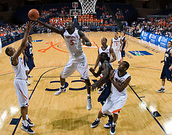 Virginia center Assane Sene (5) grabs a rebound.  The Virginia Cavaliers defeated the Shepherd Rams 87-52 in an NCAA basketball exhibition game at the University of Virginia's John Paul Jones Arena in Charlottesville, VA on November 9, 2008.