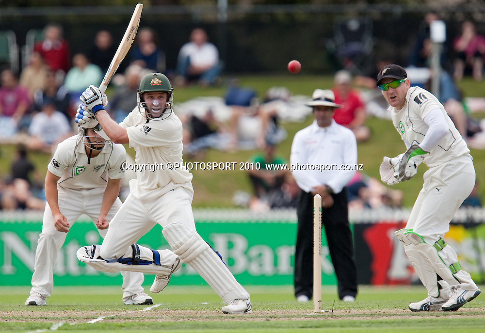 Michael Hussey hits with Brendon McCullum and BJ Watling fielding close during day one of the 2nd cricket test match between NZ Black Caps and Australia, at Seddon Park, Hamilton, 27 March 2010. Photo: Stephen Barker/PHOTOSPORT