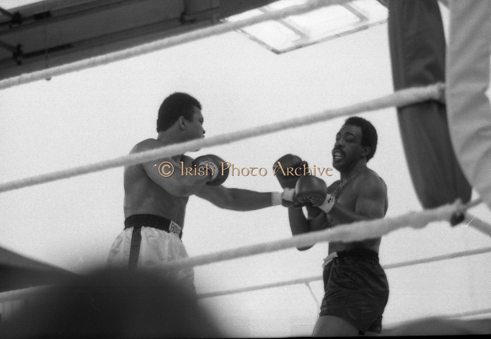 Ali vs Lewis Fight, Croke Park,Dublin.<br /> 1972.<br /> 19.07.1972.<br /> 07.19.1972.<br /> 19th July 1972.<br /> As part of his built up for a World Championship attempt against the current champion, 'Smokin' Joe Frazier,Muhammad Ali fought Al 'Blue' Lewis at Croke Park,Dublin,Ireland. Muhammad Ali won the fight with a TKO when the fight was stopped in the eleventh round.<br /> <br /> Photo of Lewis parrying a left from Ali.