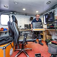 Nederland, Amsterdam, 7 juli 2016.<br /> Milieuclub Oceana ligt met haar onderzoeksschip Neptune in de Coenhaven van Amsterdam. Ze hebben geld gekregen van de postcodeloterij en gaan twee maanden op de Noordzee onderzoek doen hoe de visstand verbeterd zou kunnen worden.<br /> Op de foto: Het schip wordt klaargemaakt voor vertrek.<br /> Apparatuur wordt aan boord getakeld en geinstalleerd voor de wetenschappers aan boord van het schip.<br /> <br /> Netherlands, Amsterdam, July 7, 2016.<br /> Environmental Club Oceana with her research vessel Neptune docked in the Coenhaven harbour of  Amsterdam. They have received money from the postcode lottery and will do research in the North Sea during two months to find out how fish stocks could be improved.<br /> <br /> Foto: Jean-Pierre Jans