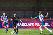 Ji So-Yun (Chelsea) with Ellie Brazil (Brighton) on her way over during the FA Women's Super League match between Brighton and Hove Albion Women and Chelsea at The People's Pension Stadium, Crawley, England on 15 September 2019.