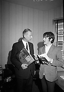 Singer Johnny McEvoy is presented with Gael Linn Buntus Cainte records and book, designed to teach Irish to those with very little knowledge of the language. The successful package was completed by a series of programmes on RTE. McEvoy had a No.1 hit in 1966 with 'Mursheen Durkin', followed by 'The Black Velvet Band'..15.09.1967