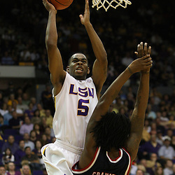 14 February 2009 LSU guard Marcus Thornton (5) shoots over DeAundre Cranston (52) of Ole Miss during 73-66 win by the LSU Tigers against SEC rival the Ole Miss Rebels at the Pete Maravich Assembly Center in Baton Rouge, LA.