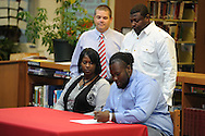 Lafayette High's D.Q. Reynolds (63) signs a National Letter of Intent to play football at Itawamba Community College, in Oxford, Miss. on Wednesday, February 1, 2012.
