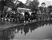 24/05/1958<br /> 05/24/1958<br /> 24 May 1958<br /> Military tattoo at Santry Stadium, Dublin. <br /> Combined piper bands at Santry brave the rain.
