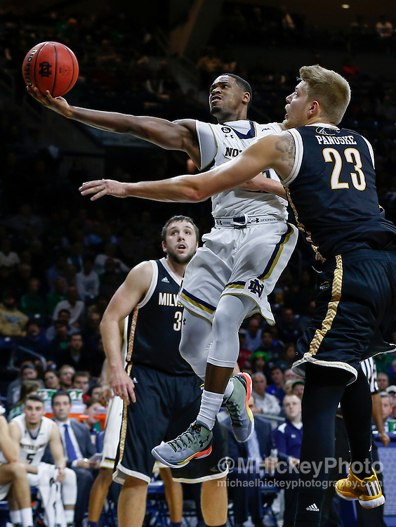 SOUTH BEND, IN - NOVEMBER 17: Demetrius Jackson #11 of the Notre Dame Fighting Irish shoots the ball against J.J. Panoske #23 of the Milwaukee Panthers at Purcell Pavilion on November 17, 2015 in South Bend, Indiana. (Photo by Michael Hickey/Getty Images) *** Local Caption *** Demetrius Jackson; J.J. Panoske