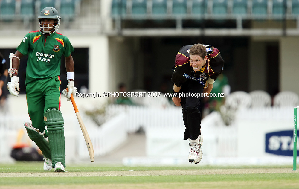 Mark Orchard bowls with Bangladesh batsman Zunaed Siddique at left. Northern Knights v Bangladesh. One day tour cricket match. Seddon Park, Hamilton. Sunday 16 December 2007. Photo: Stephen Barker/PHOTOSPORT