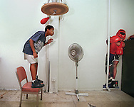 Dante Rogers age 13, stands and dodges a speed bag during a workout at the Sacramento Police Athletic League. He's been using the gym for about two months.