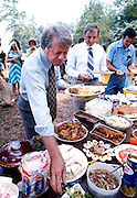 "Democratic presidential nominee Jimmy Carter and VP nominee Walter ""Fritz"" Mondale have a picnic lunch on the grounds after a Sunday service at the Plains, GA Baptist Church."