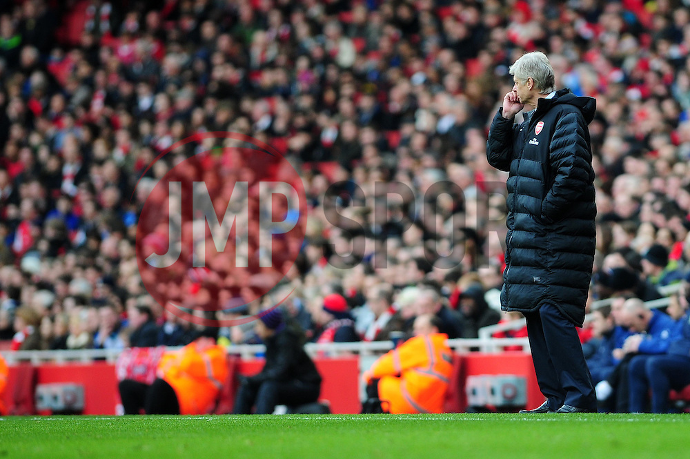 Arsenal Manger, Arsene Wenger watches his team on the attack - Photo mandatory by-line: Dougie Allward/JMP - Tel: Mobile: 07966 386802 16/02/2013 - SPORT - FOOTBALL - Emirates Stadium - London -  Arsenal V Blackburn Rovers - FA Cup - Fifth Round