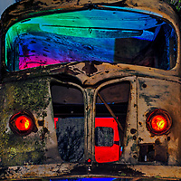 Rusty old van with added lights in Northern California.