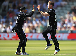 New Zealand's James Neesham (right) celebrates the wicket of Australia's Marcus Stoinis (not pictured) during the ICC Cricket World Cup group stage match at Lord's, London.
