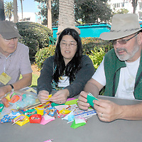 Pat Kuramoto teaches Origami to James Curley (left) and Joe Deering (right) during Senior & Family Intergenerational Arts Festival: Celebration of Life on Saturday, October 9, 2010.