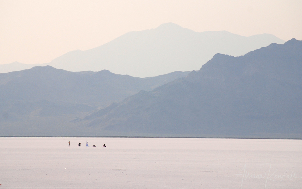 A distant photoshoot appears as a mirage on the Bonneville salt flats.