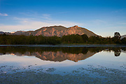 Mount Si, a 4167 ft (1270 m) high mountain located in North Bend, Washington, is reflected in the relatively calm waters of Borst Lake.